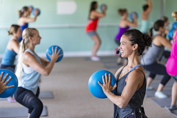 Instructor and students at a barre fitness class in Kamloops, British Columbia, Canada