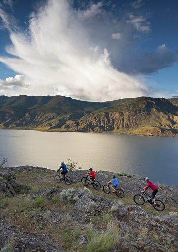 A family of bikers enjoy a stellar day over Kamloops Lake, west of Kamloops, Thompson Okanagan region, British Columbia, Canada
