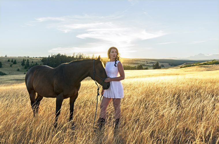 A beautiful woman and her horse at sunset, near Kamloops, British Columbia, Canada