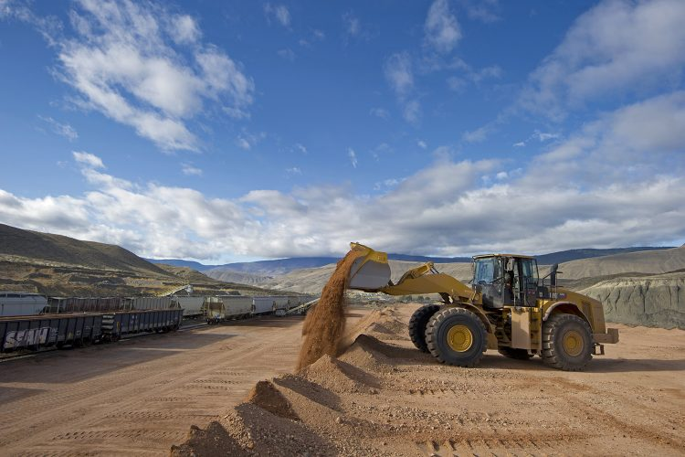 A front end loader works at the train storage facility in Ashcroft, British Columbia, Thompson Okanagan region, Canada