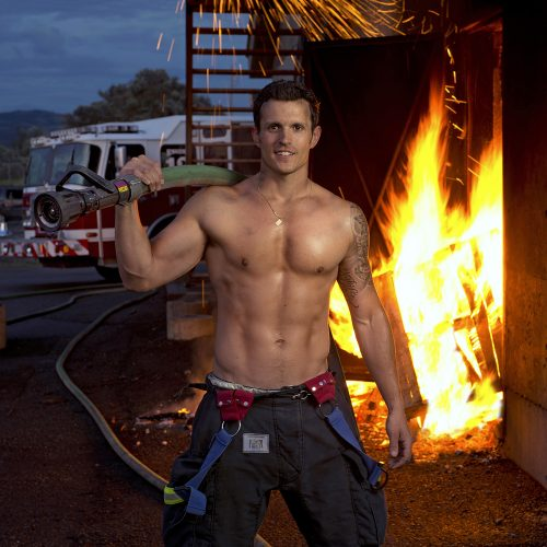 A firefighter poses for the annual Kamloops calendar for charity, Kamloops, British Columbia, Canada