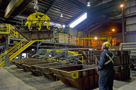 Steel ball used in the mining industry getting loaded for transport, Molycop, Kamloops, British Columbia, Canada