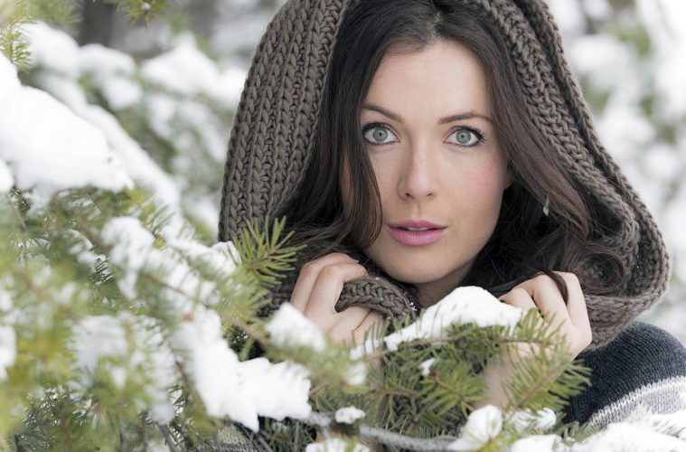 A beautiful young woman poses during a commercial head shoot near Kamloops, British Columbia, Canada