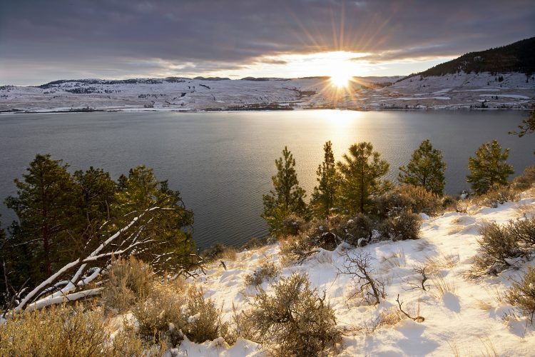 Nicola lake shines with sunrise in the winter, near Merritt, Thompson Nicola region, British Columbia, Canada