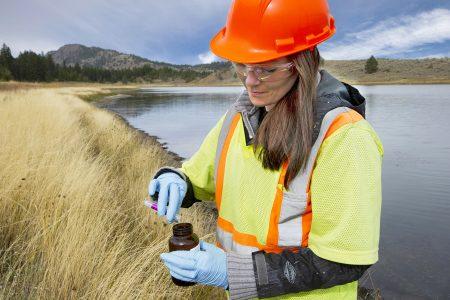 A biologist tests water samples near a mining operation, west of Kamloops, British Columbia, Thompson Okanagan region, Canada