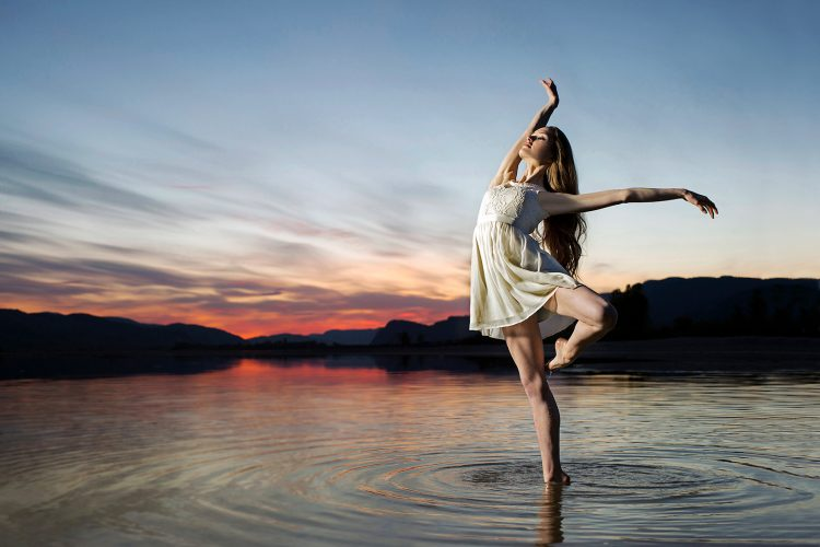 A young ballerina performs during a conceptual portrait session at sunset, near Kamloops, British Columbia, Canada