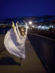 A young woman performs ballet at dusk in Kamloops, British Columbia, Thompson Okanagan region, Canada.