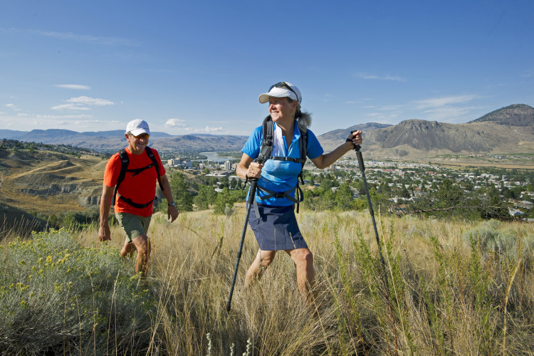 Hiking above Kamloops, middle aged couple, sunshine, grasslands