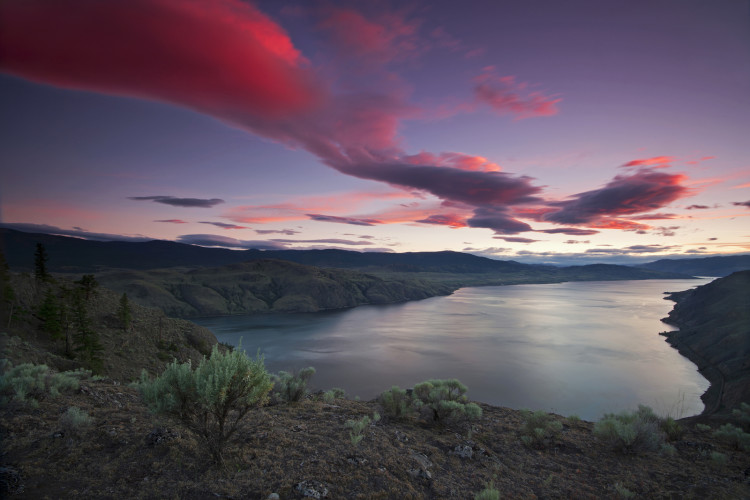 Kamloops lake at sunset, west of Kamloops, Battle bluffs, sage, red sky