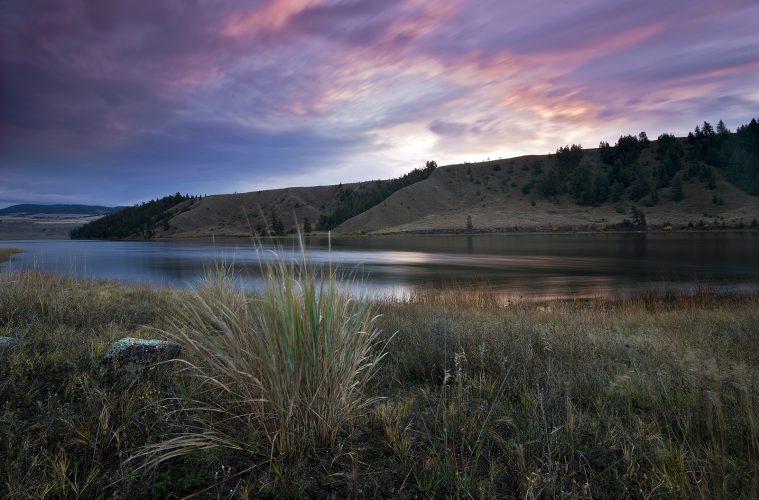 Landscape image of sunrise over Trapp lake, near Kamloops, British Columbia, Thompson Okanagan region, Canada