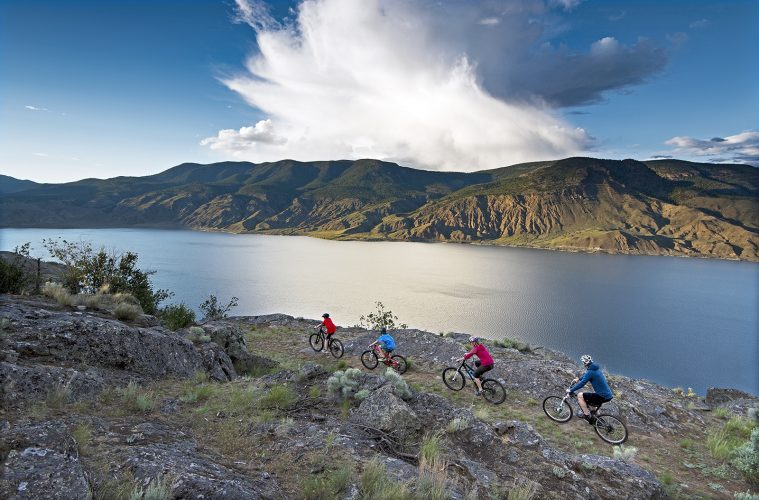 A family of bikers enjoys a fantastic ride over Kamloops lake, west of Kamloops, British Columbia, Canada