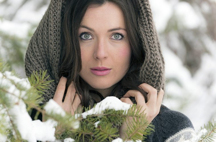 A beautiful young woman poses in the forest for a portrait near Kamloops, BC, Canada
