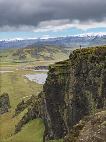 A photographer takes in the view near Dyrhólaey in southern Iceland, Europe
