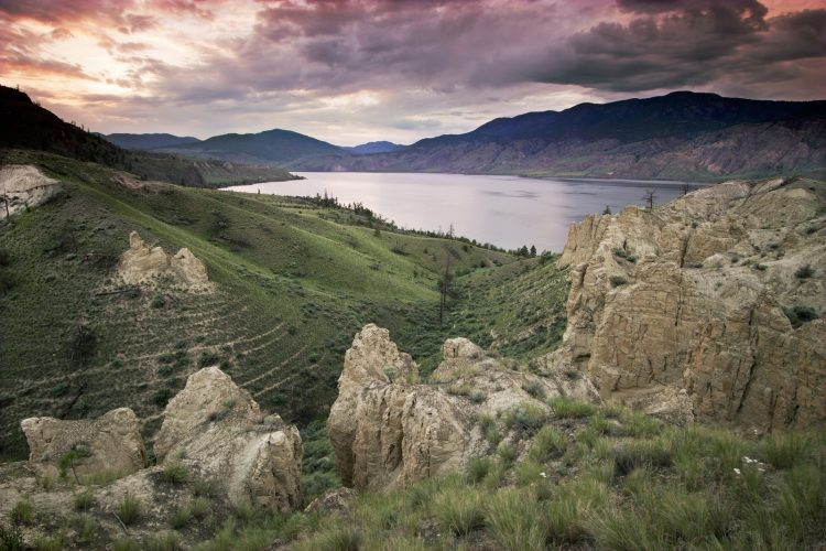 Hoodoos create the foreground at sunset over Kamloops, west of Kamloops, Thompson Okanagan region, British Columbia, Canada