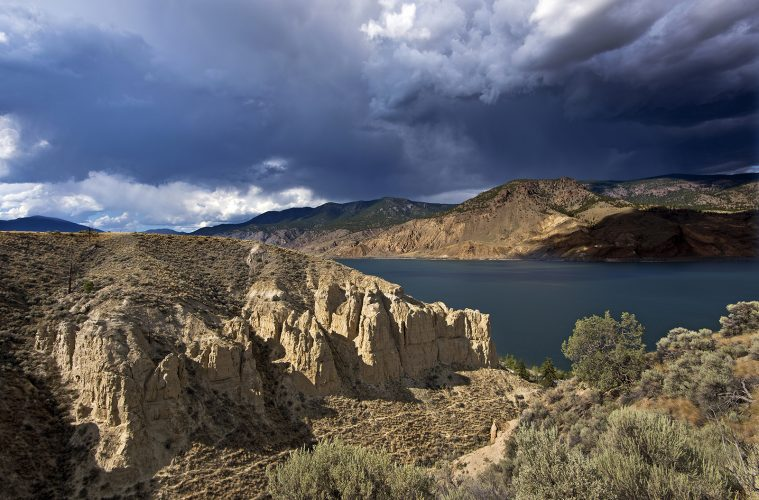 Landscape of Hoodoos and Kamloops lake before a storm, west of Kamloops, Thompson Okanagan region, British Columbia, Canada