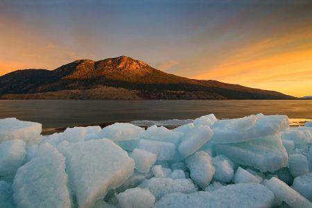 Sunrise over Nicola lake during spring break up, South of Kamloops, Thompson Okanagan region, British Columbia, Canada