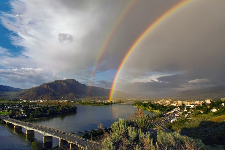 A double rainbow falls over Kamloops and the junction of the north and south Thompson rivers, Thompson Okanagan region, British Columbia, Canada