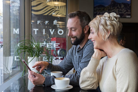 A couple enjoys getting coffee at Caffe Motivo in Kamloops, British Columbia, Canada