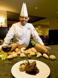 A chef surveys his preparations at the Jasper Park Lodge, Jasper, Alberta, Canada