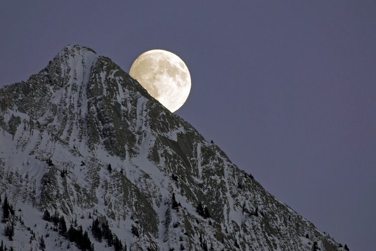 Moonrise over the Rocky Mountains, east of Jasper National Park, Alberta, Canada
