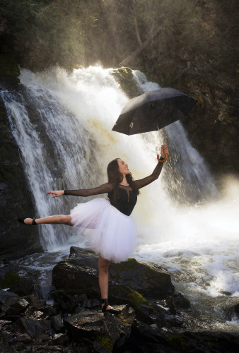 A beautiful, young ballet dancer embraces spring under the Chase waterfalls, Chase, British Columbia, Thompson Okanagan region, Canada