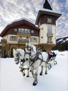 Tourists on a sleigh ride through the village of Sun Peaks resort, north of Kamloops, Thompson Okanagan region, British Columbia, Canada