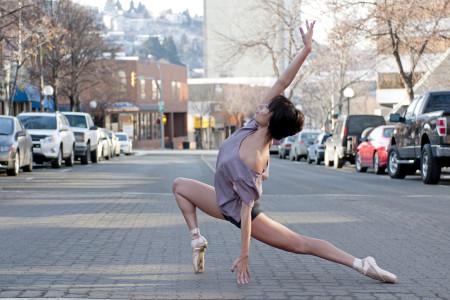A female ballerina poses on Victoria street in Kamloops, Thompson Okanagan region, British Columbia Canada,  Nikon Canada