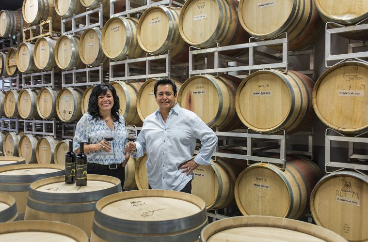 The owners in their storage facility at Indigenous World Winery, Kelowna, BC, Canada