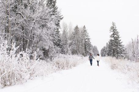 A couple enjoys a hike on a beautiful winter day near Kamloops, Thompson Okanagan region, British Columbia, Canada