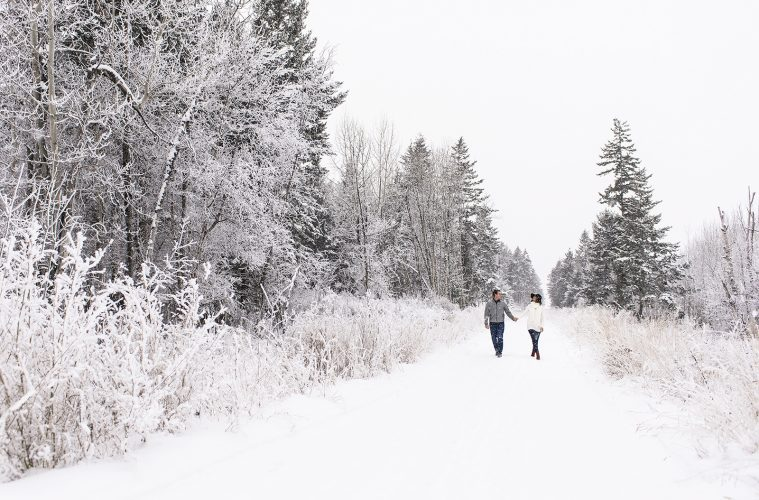 A couple enjoys a hike on a beautiful winter day near Kamloops, Thompson Okanagan region, British Columbia, Canada