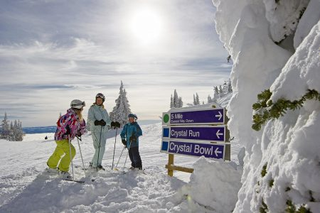 A family skiing, at Sun Peaks Resorty, north of Kamloops, Thompson Okanagan region, British Columbia, Canada