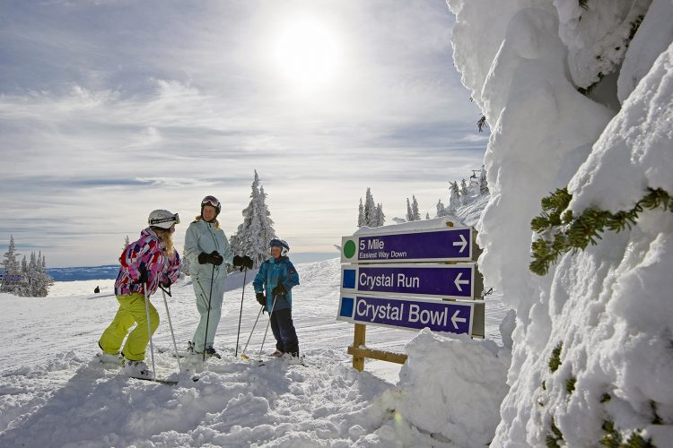 A family skiing, at Sun Peaks Resorty, north of Kamloops, Thompson Okanagan region, British Columbia, Canada
