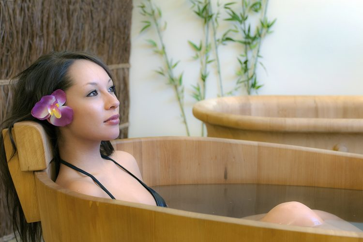 A young woman relaxes at the Sunmore Ginseng Spa in Kamloops, British Columbia, Thompson Okanagan region, Canada