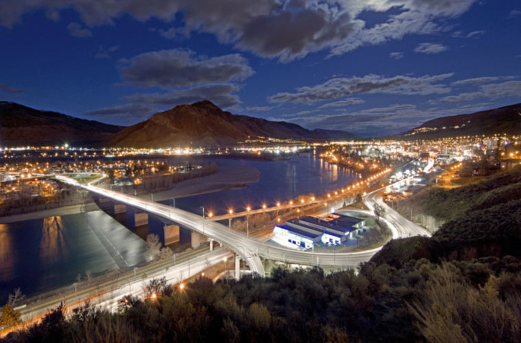 The city of Kamloops at dusk and city lights with the north and south Thompson rivers, Thompson Okanagan region, British Columbia, Canada