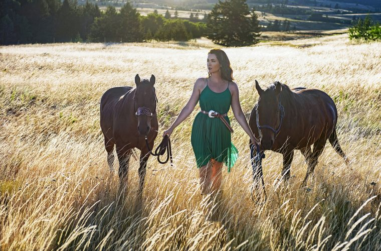 Portrait of a beautiful woman and her horses near Kamloops, British Columbia, Canada