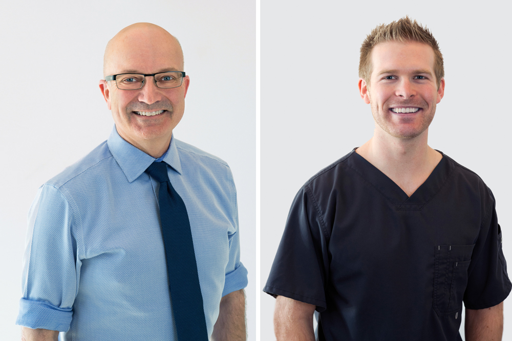 Two male dentists pose for a portrait during a commercial shoot at a dental clinic in Kamloops, British Columbia, Thompson Okanagan region, Canada