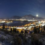 City of Kamloops, BC, Canada at night with lights and moon
