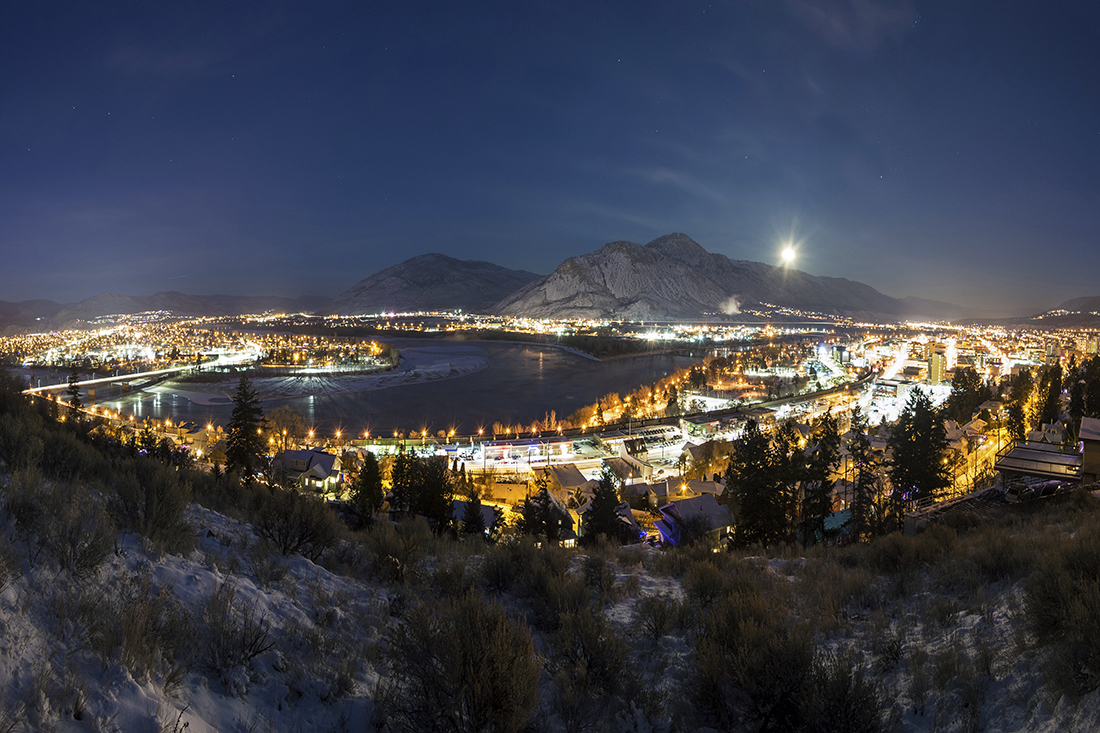 City of Kamloops, BC, Canada at night with lights and moon