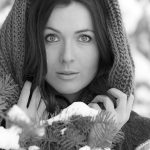 Portrait of a young, beautiful woman in the snow covered forest near Kamloops, British Columbia, Thompson Okangan region, Canada