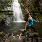 A young woman practices yoga at a waterfall near Kamloops and Sun Peaks, Thompson Okanagan region, British Columbia, Canada