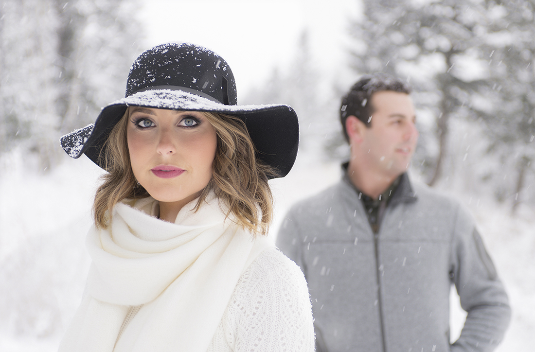 Couple getting portraits in the snow during their engagement, Kamloops, British Columbia, Canada