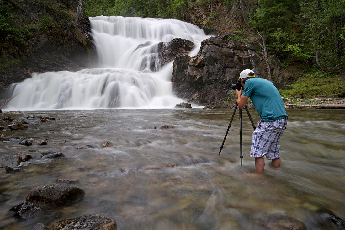 Photographer taking an image of Albas Falls, Shuswap region, British Columbia, Canada