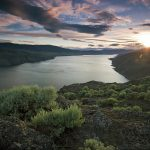 Landscape image of Battle Bluff area over Kamloops Lake at sunset, Thompson Okanagan region, British Columbia, Canada