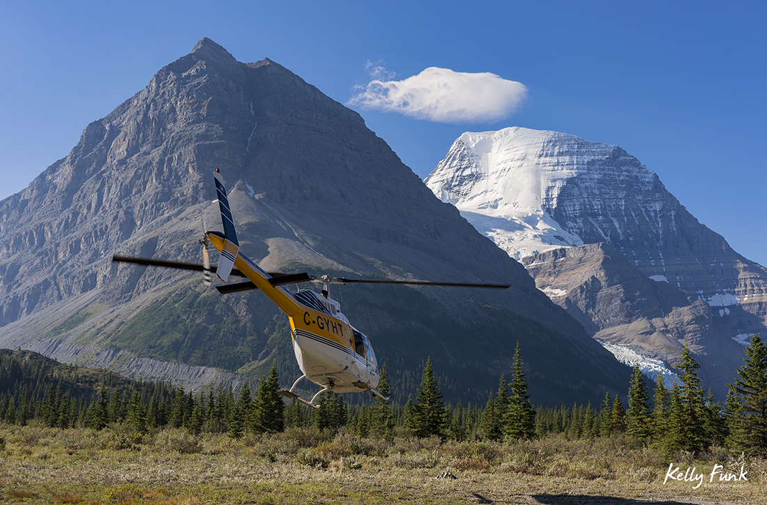 Robson Heli-Magic leaves Mt. Robson near Berg Lake in the Canadian Rocky Mountains, British