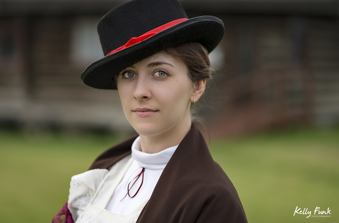 A beautiful young woman poses for a period image outside the museum in Vanderhoof, British Columbia, Canada