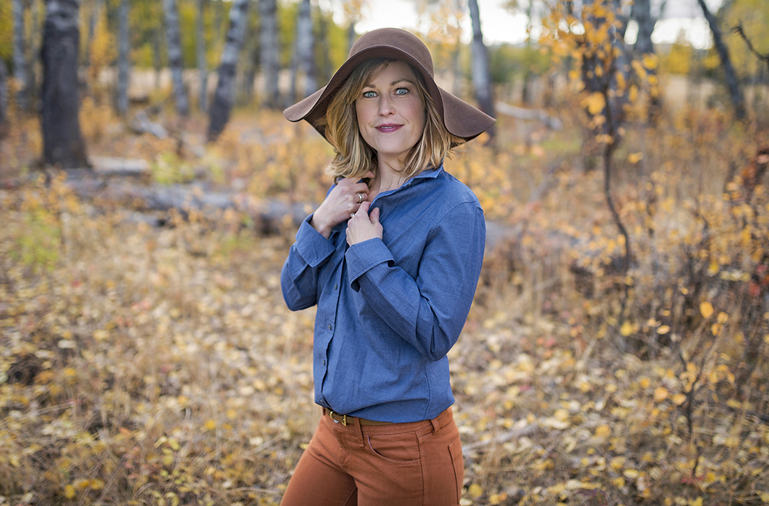 A young woman with blue eyes poses for a portrait on a beautiful fall day near Kamloops, British Columbia, Canada, Thompson Okanagan region