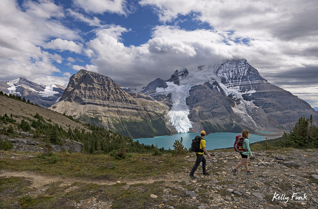 Two hikers make their way up the Mumm basin, Mt. Robson Provincial park, British Columbia, Canada