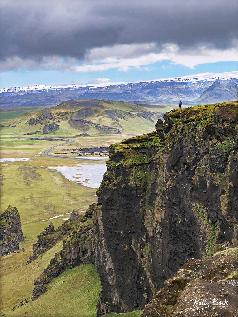 Photographer stands on a cliff in south east Iceland, Europe in the spring