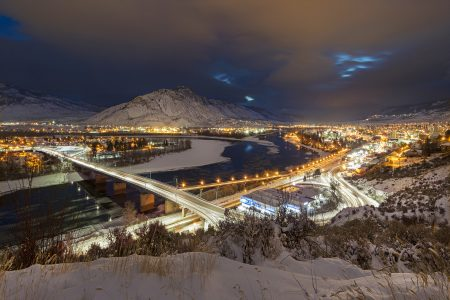 First light after a fresh snow fall over the city and city lights of Kamloops, British Columbia, Thompson Okanagan region, Canada
