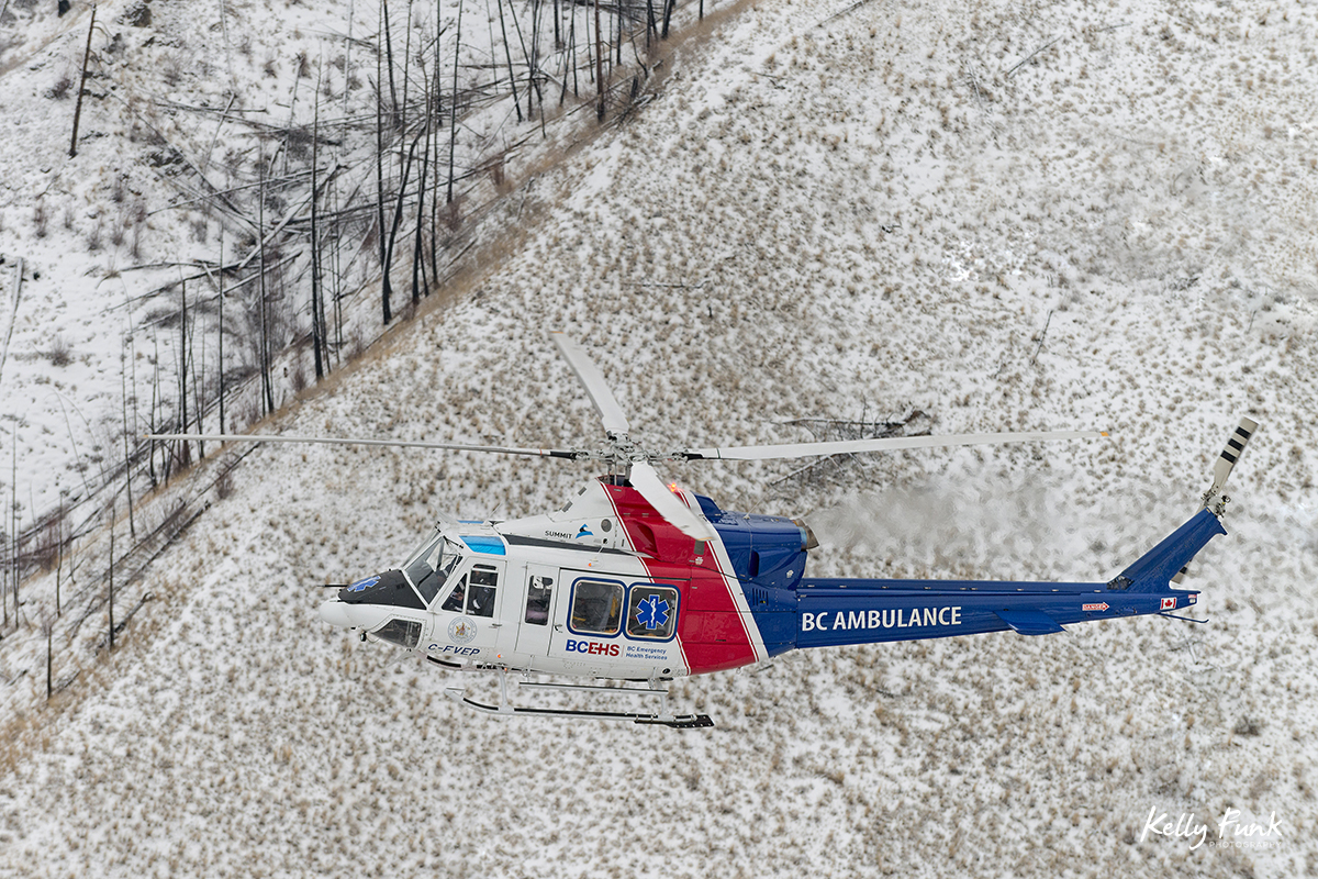 The BC Air Ambulance rescue helicopter is photographed from a second heli during a commercial shoot just west of Kamloops, British Columbia, Canada